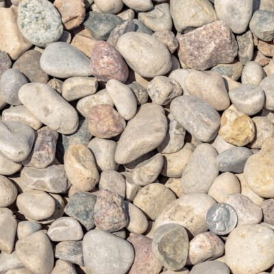 "Decorative 1-1/2"" American Heritage stones and landscaping rocks with quarter"