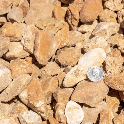 1-1/2 inch Meramec Landscape Stones with Quarter Comparison