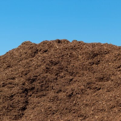 A pile of double shredded hardwood mulch