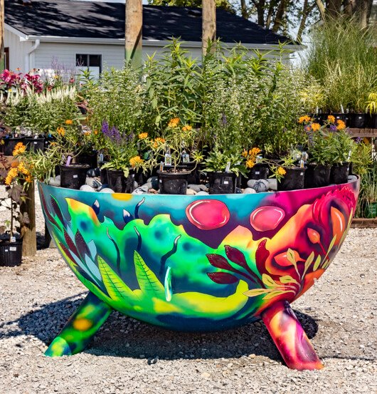 Colorful table with plants on top in garden center